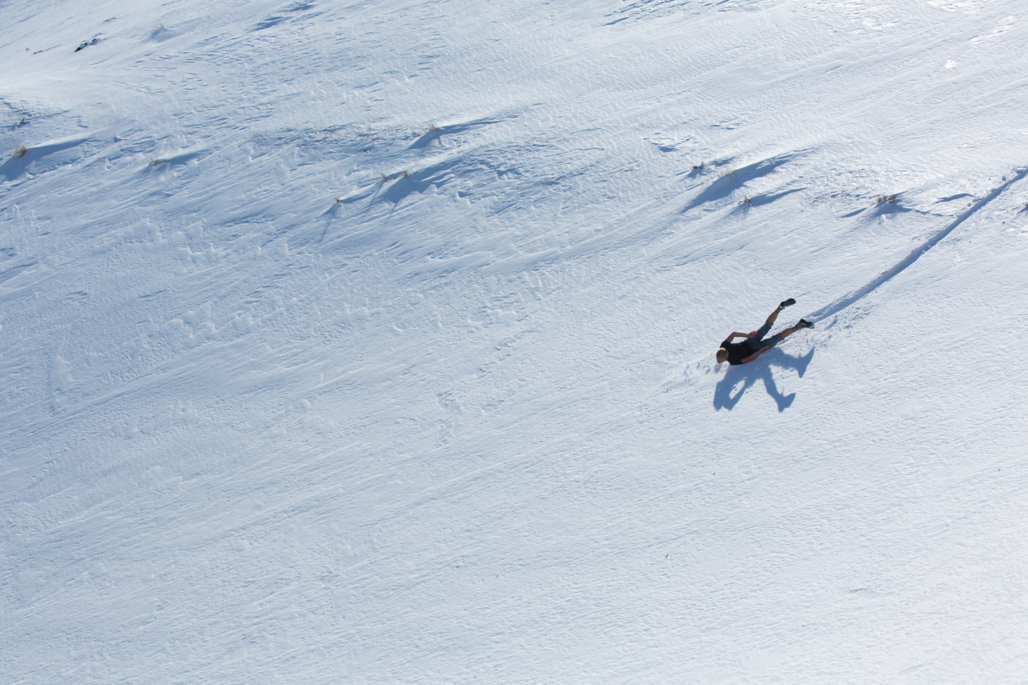 Bridger sliding like a penguin on its belly.